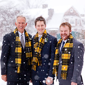 Three men wearing scraves in the snow | Sheknows.ca