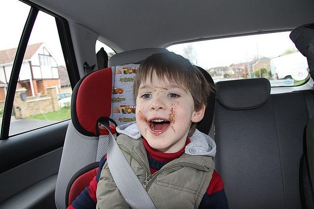 Messy kid in car