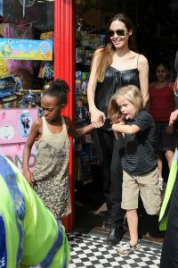 What inspired Angelina Jolie to adopt?