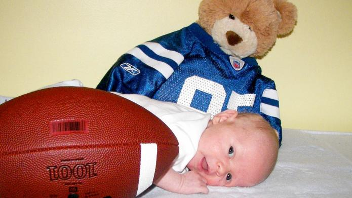 12 Adorable babies in football uniforms,