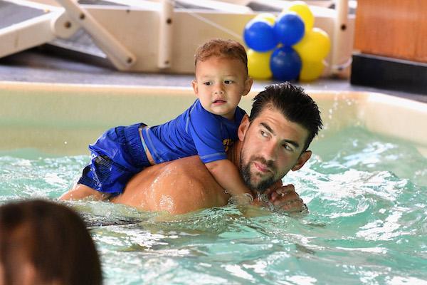 Michael Phelps teaches son Boomer how to swim