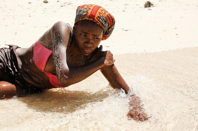 Michaela Bradshaw lays on the beach during Survivor: Millennials Vs. Gen-X