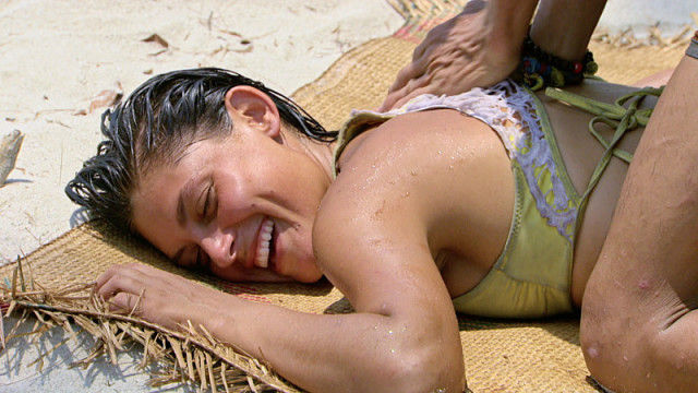 Michele Fitzgerald gets back rub at camp on Survivor: Kaoh Rong