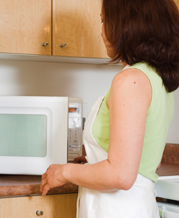 Woman Cooking in the Microwave