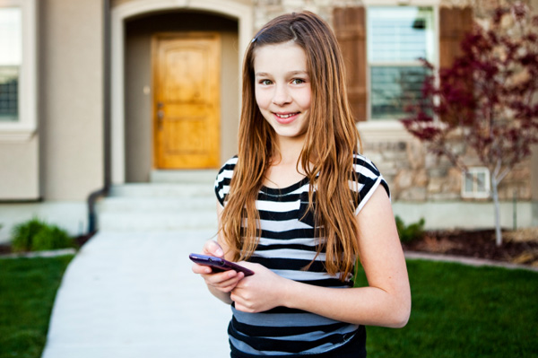 Middle school girl on cell phone