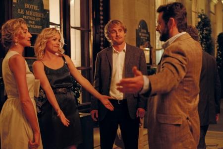 Michael Sheen greets Rachel McAdams and Owen Wilson in Midnight in Paris