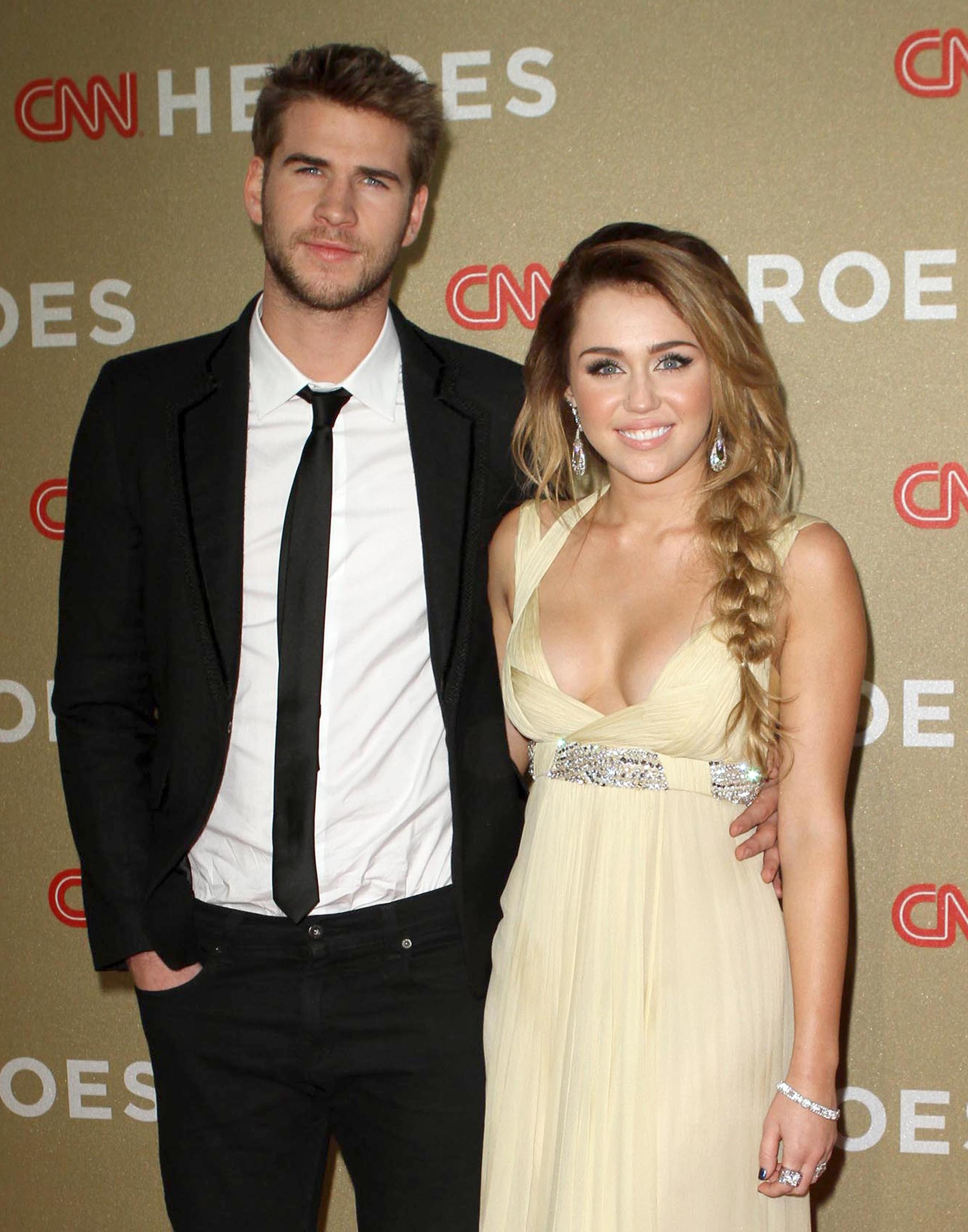 42be80293 Miley Cyrus announced her engagement to actor Liam Hemsworth today, but we  all know what we're really thinking is: What does the ring look like?