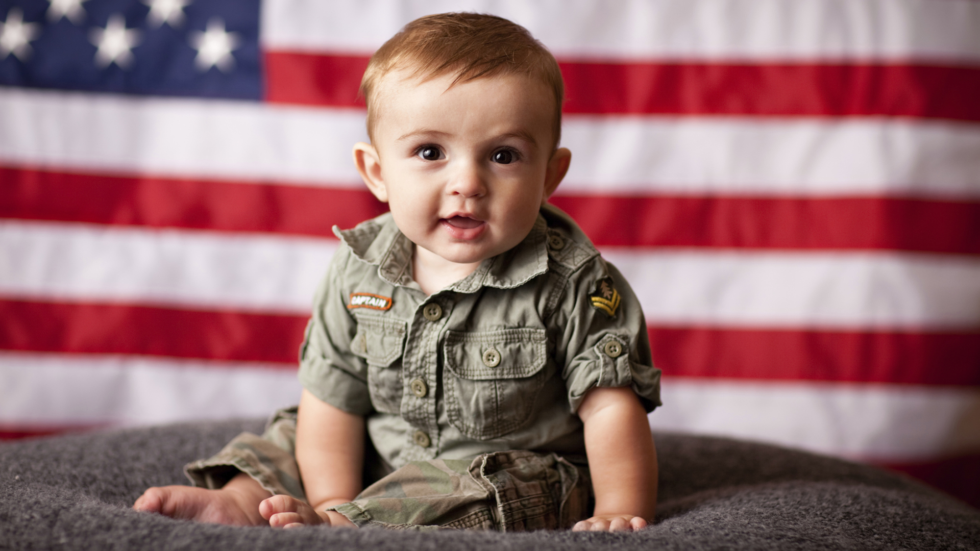 Military baby with american flag | Sheknows.com