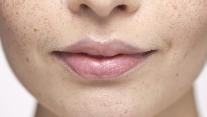 Close-up of young woman's face and