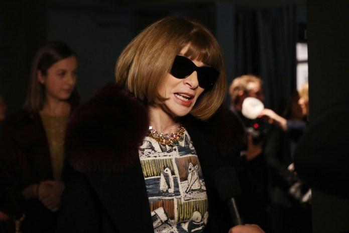 Anna Wintour Hands Over Sunglasses, World