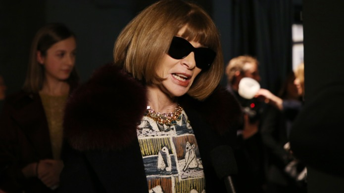 Anna Wintour Hands Over Sunglasses, World