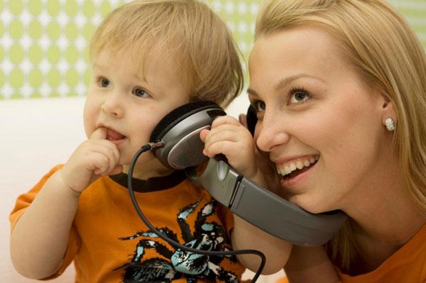 Mum and baby listening to music