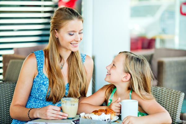 Mom and daughter at cafe