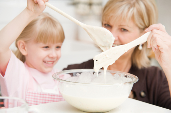mom and daughter cooking substituting ingredients with yogurt