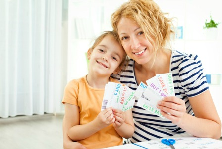 Mom and daughter with coupons