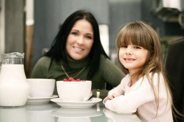 Mom and daughter eating cereal