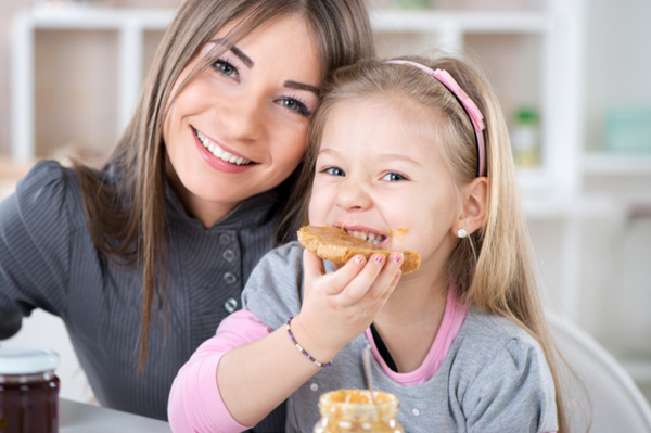Mom and daughter enjoy snack together