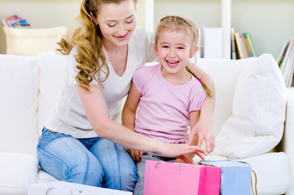 Mom and little girl with shopping bags