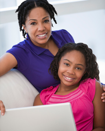 Mom and tween girl on computer