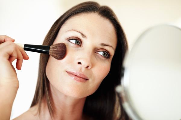 Mom applying mineral makeup