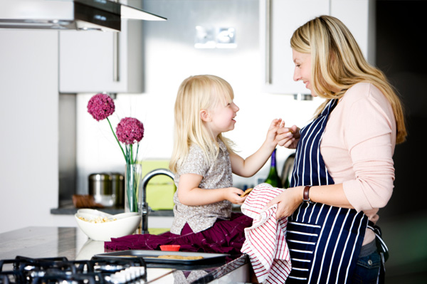 Mom baking Valentine's Day cookies with daughter