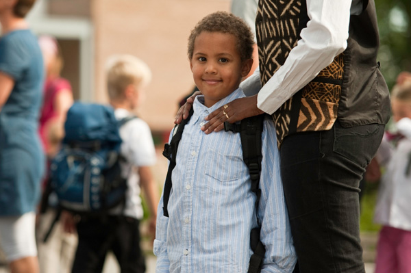 Mom bringing kindergartener to school