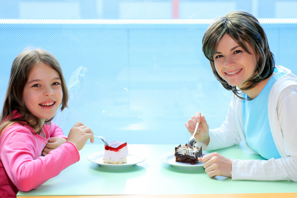 Mom and daughter bonding over cake