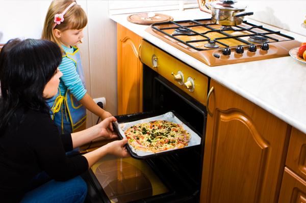 Mom making pizza