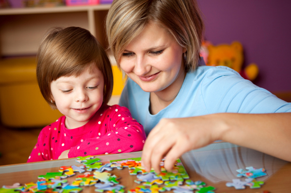 mom doing puzzles with daughter