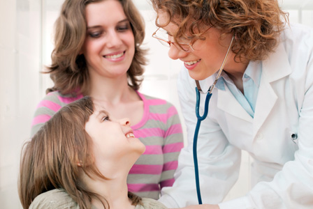 Mom with daughter visiting doctor