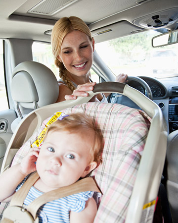 mom driving baby in car seat