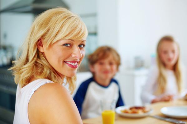 Mom having breakfast with kids
