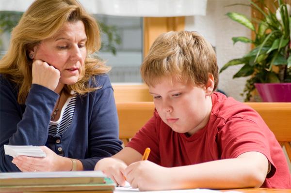 Mom helping son read
