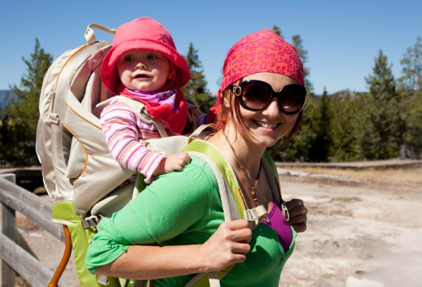 mom hiking with baby in carrier on back