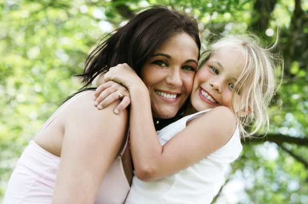 mother hugging young daughter