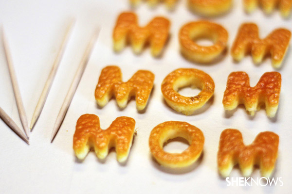 """Creating the """"MOM"""" letters on a toothpick"""