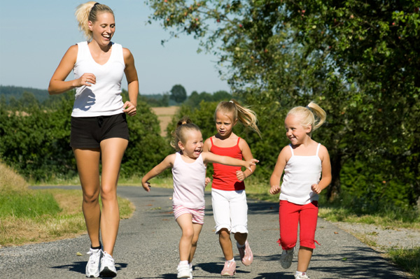 Mom running with kids