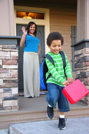 Mom sending son to school with lunchbox