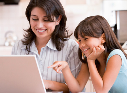 Mom shopping online with daughter