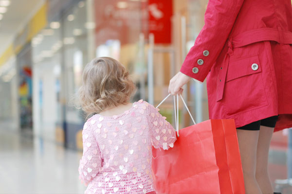 Mom shopping with little girl