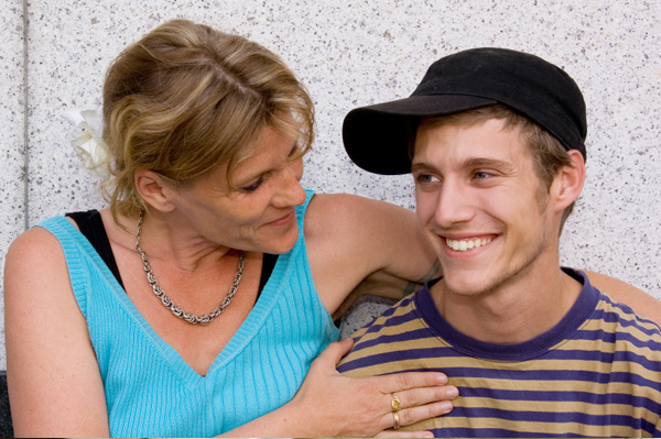 Mom smiling at teen son