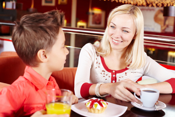 Mom and son in cafe