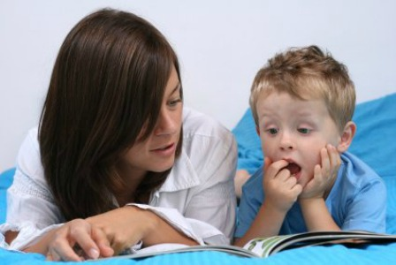 Mom reading with her son