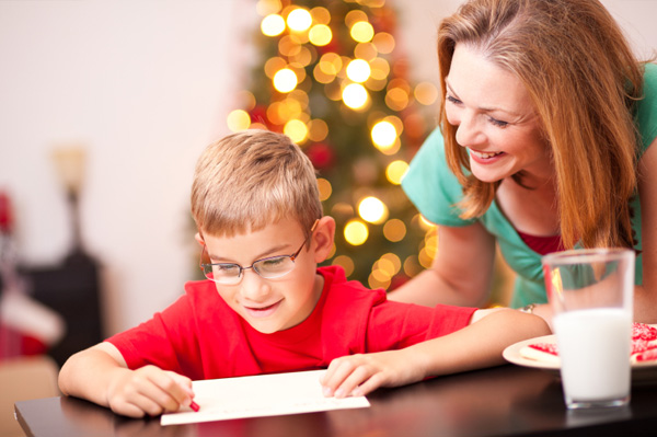 Mom and son writing letter to santa