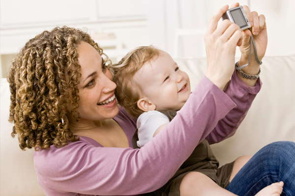 Mom taking photo with child