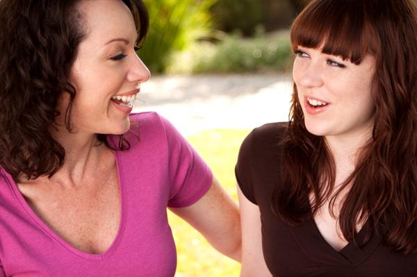 Mum talking to teen daughter