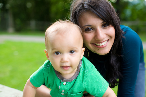 Mom with baby in green
