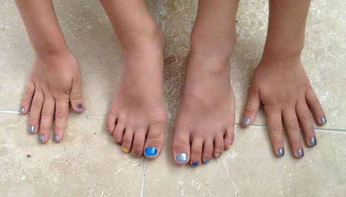 child with painted nails