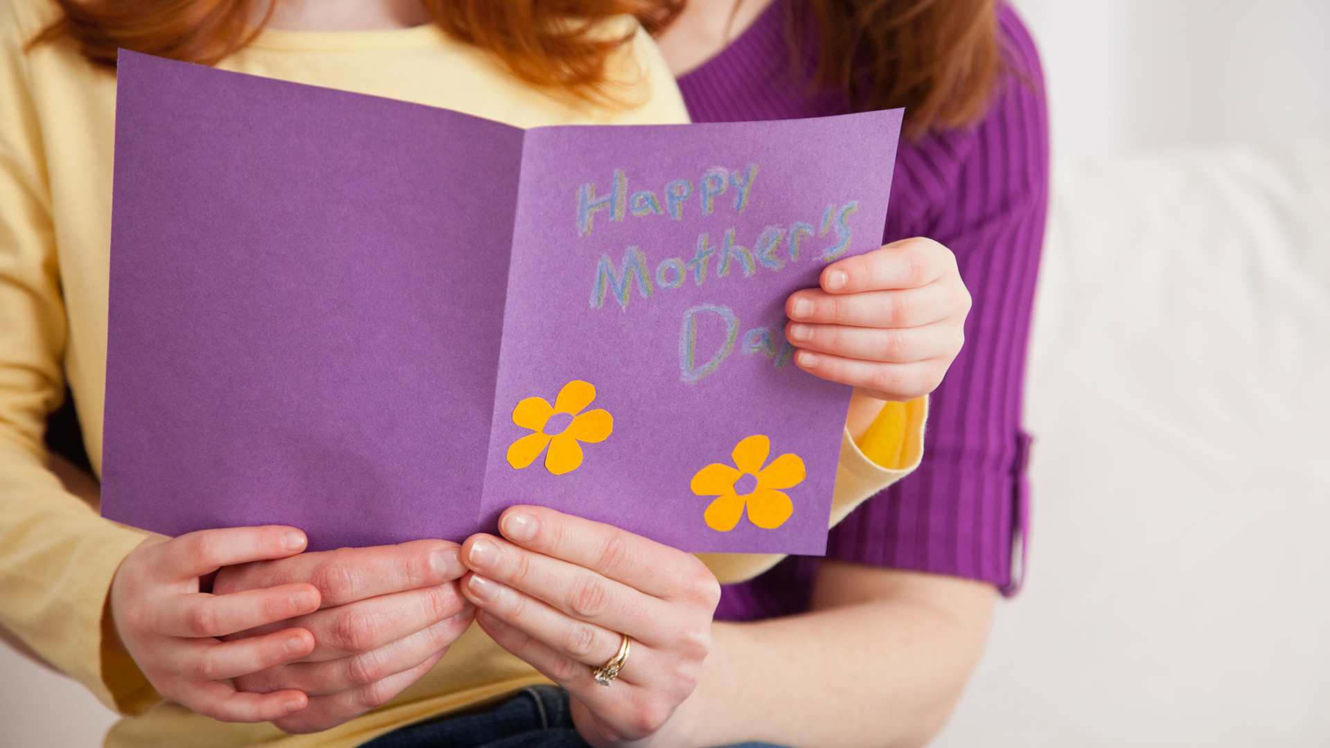 Mother and child holding mother's day card | Sheknows.com