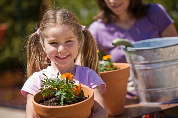 Mom gardening with kids